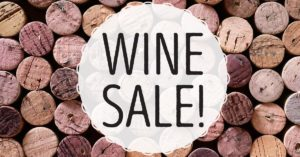Wine Sale graphic. Wine cork texture in the background.