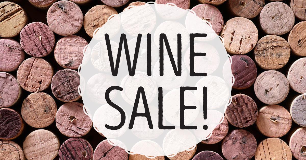 Wine Sale graphic. Wine cork texture in the background.